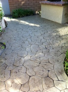 Stamped concrete stained with Powdered Sage Solid Color and Translucent Color Enhancer