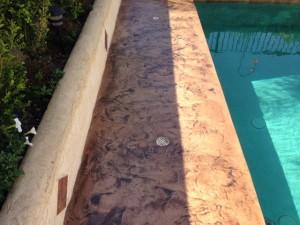 Stamped Pool Deck: - Sierra Solid Base - Seasoned Earth TiqueWash - SmartSeal WB